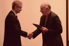 Dr. Charley Richard accepting the incoming president's plaque for Ron Kawlewski